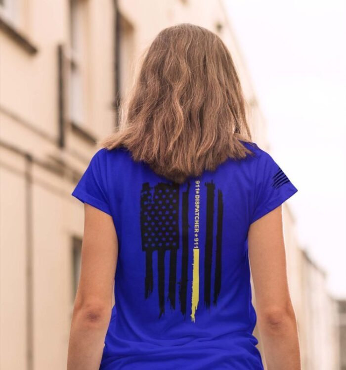 Thin gold line flag on womans royal blue