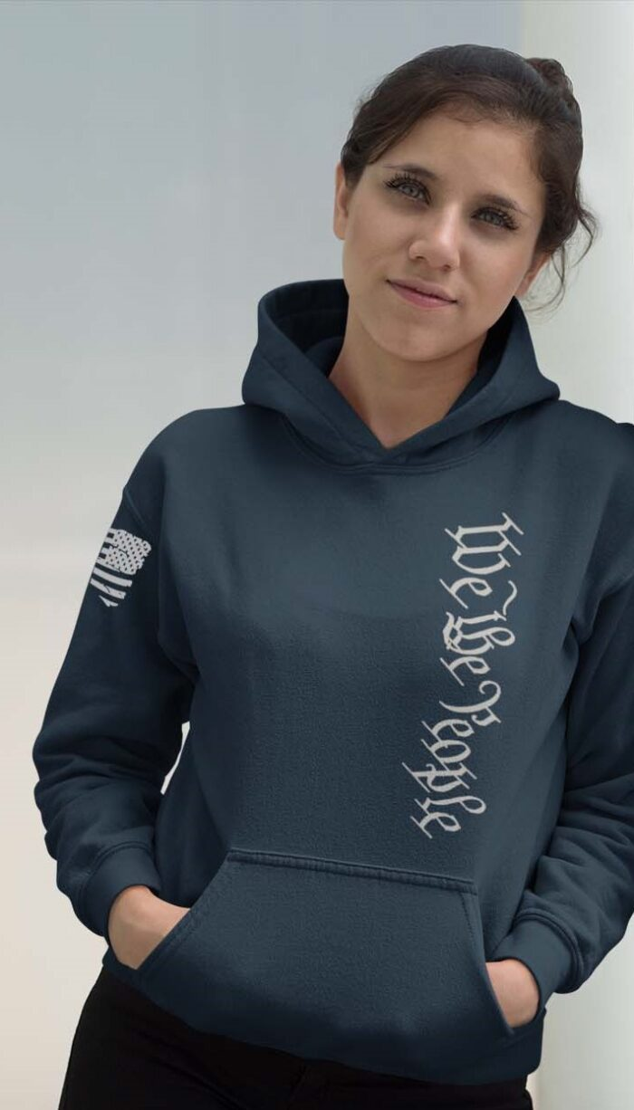 Vertical We the people on a navy light weight hoodie